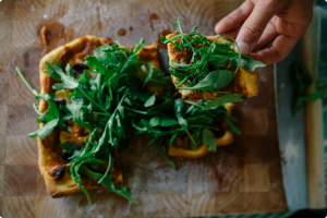homemade pizza with fresh rocket